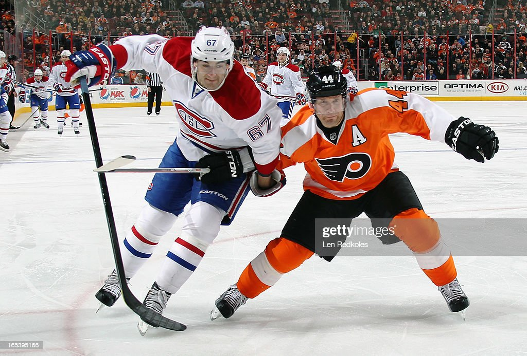 <a gi-track='captionPersonalityLinkClicked' href=/galleries/search?phrase=Kimmo+Timonen&family=editorial&specificpeople=201521 ng-click='$event.stopPropagation()'>Kimmo Timonen</a> #44 of the Philadelphia Flyers battles for position with <a gi-track='captionPersonalityLinkClicked' href=/galleries/search?phrase=Max+Pacioretty&family=editorial&specificpeople=4324972 ng-click='$event.stopPropagation()'>Max Pacioretty</a> #67 of the Montreal Canadiens on April 3, 2013 at the Wells Fargo Center in Philadelphia, Pennsylvania.