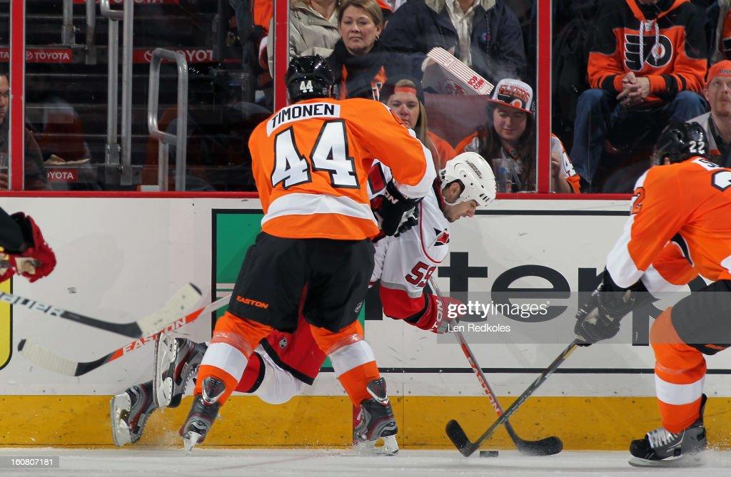 Kimmo Timonen #44 of the Philadelphia Flyers battles for the puck as he checks Chad Larose #59 of the Carolina Hurricanes on February 2, 2013 at the Wells Fargo Center in Philadelphia, Pennsylvania.