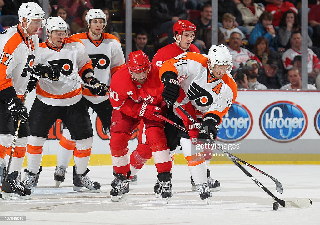 <a gi-track='captionPersonalityLinkClicked' href=/galleries/search?phrase=Kimmo+Timonen&family=editorial&specificpeople=201521 ng-click='$event.stopPropagation()'>Kimmo Timonen</a> #44 of the Philadelphia Flyers battles with <a gi-track='captionPersonalityLinkClicked' href=/galleries/search?phrase=Henrik+Zetterberg&family=editorial&specificpeople=201520 ng-click='$event.stopPropagation()'>Henrik Zetterberg</a> #40 of the Detroit Red Wings for puck control in a game on January 2, 2011 at the Joe Louis Arena in Detroit, Michigan. The Flyers defeated the Wings 3-2.