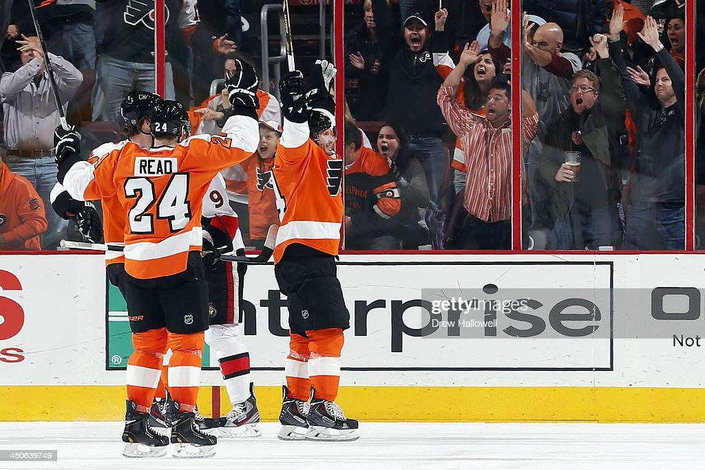 Kimmo Timonen #44 of the Philadelphia Flyers celebrates a go ahead goal in the third period as Sean Couturier #14 look on during the game against the Ottawa Senators at the Wells Fargo Center on November 19, 2013 in Philadelphia, Pennsylvania. The Flyers won 5-2.