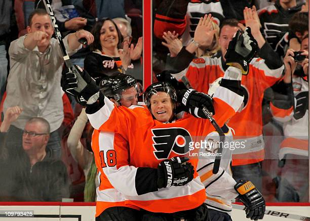Kimmo Timonen of the Philadelphia Flyers celebrates his second period shorthanded goal against the Buffalo Sabres with teammate Mike Richards on...