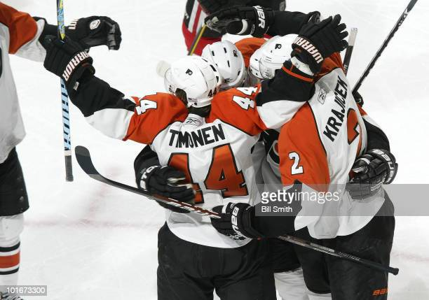 Kimmo Timonen of the Philadelphia Flyers celebrates with teammates after scoring against the Chicago Blackhawks in the second at Game Five of the...