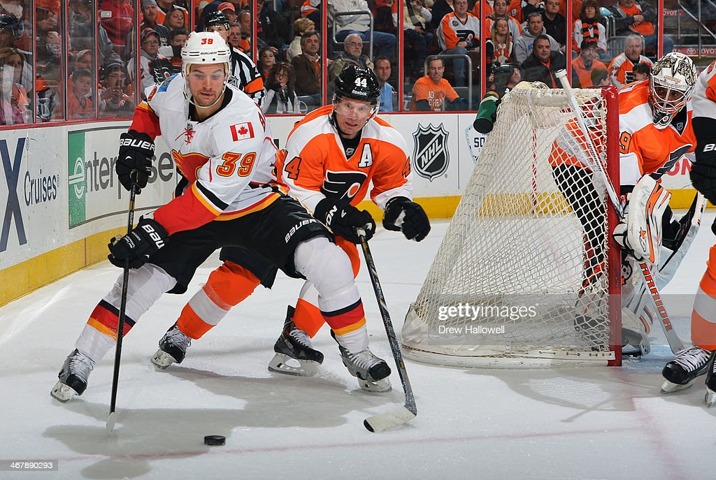 <a gi-track='captionPersonalityLinkClicked' href=/galleries/search?phrase=Kimmo+Timonen&family=editorial&specificpeople=201521 ng-click='$event.stopPropagation()'>Kimmo Timonen</a> #44 of the Philadelphia Flyers defends against <a gi-track='captionPersonalityLinkClicked' href=/galleries/search?phrase=T.J.+Galiardi&family=editorial&specificpeople=4324979 ng-click='$event.stopPropagation()'>T.J. Galiardi</a> #39 of the Calgary Flames, as <a gi-track='captionPersonalityLinkClicked' href=/galleries/search?phrase=Ray+Emery&family=editorial&specificpeople=218109 ng-click='$event.stopPropagation()'>Ray Emery</a> #29 keeps an eye on the puck at the Wells Fargo Center on February 8, 2014 in Philadelphia, Pennsylvania. The Flyers won 2-1.