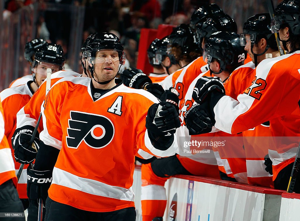 <a gi-track='captionPersonalityLinkClicked' href=/galleries/search?phrase=Kimmo+Timonen&family=editorial&specificpeople=201521 ng-click='$event.stopPropagation()'>Kimmo Timonen</a> #44 of the Philadelphia Flyers is congratulated by teammates after he scored a goal to tie the game late in the third period of an NHL hockey game against the Washington Capitals at Wells Fargo Center on March 31, 2013 in Philadelphia, Pennsylvania. Flyers won 5-4 in overtime.