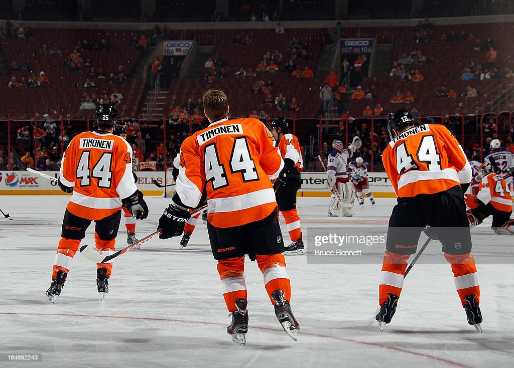Kimmo Timonen #44 of the Philadelphia Flyers (C) is honored by his teammates during warmups by all players wearing his #44 jersey prior to their game against the New York Rangers at the Wells Fargo Center on March 26, 2013 in Philadelphia, Pennsylvania.