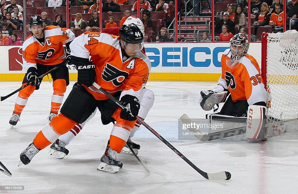 <a gi-track='captionPersonalityLinkClicked' href=/galleries/search?phrase=Kimmo+Timonen&family=editorial&specificpeople=201521 ng-click='$event.stopPropagation()'>Kimmo Timonen</a> #44 of the Philadelphia Flyers keeps possession of the puck in the corner against the Phoenix Coyotes on October 11, 2013 at the Wells Fargo Center in Philadelphia, Pennsylvania. The Coyotes went on to defeat the Flyers 2-1.