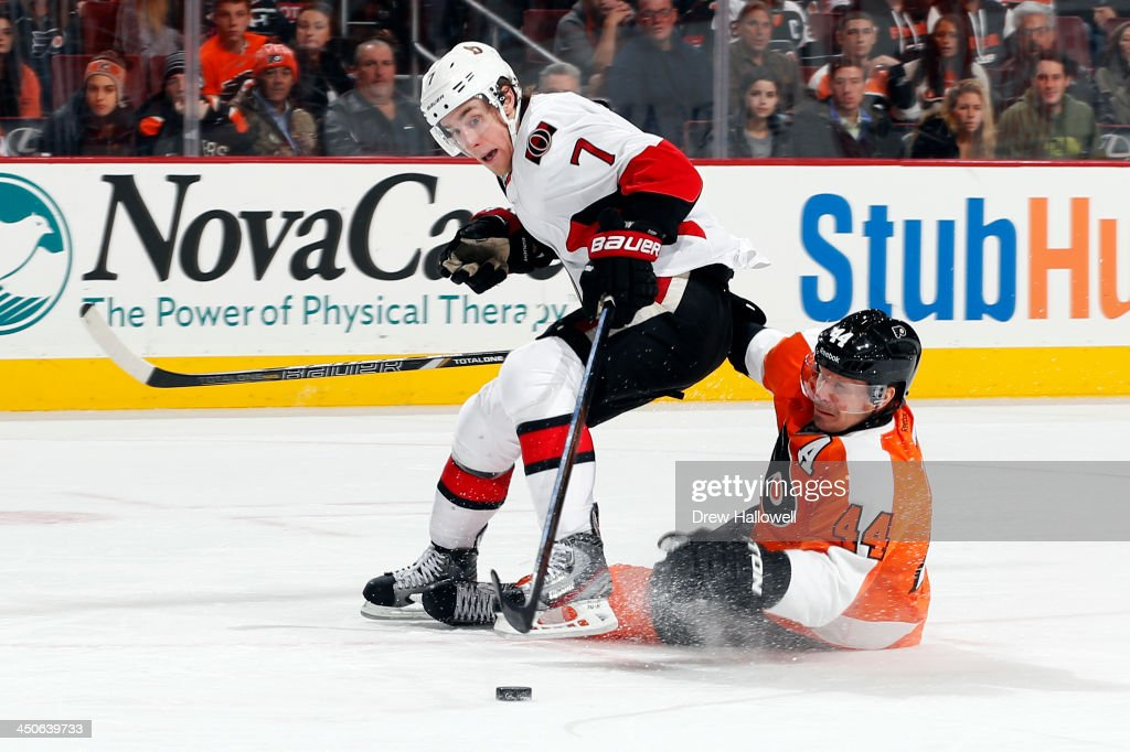 <a gi-track='captionPersonalityLinkClicked' href=/galleries/search?phrase=Kimmo+Timonen&family=editorial&specificpeople=201521 ng-click='$event.stopPropagation()'>Kimmo Timonen</a> #44 of the Philadelphia Flyers pulls down <a gi-track='captionPersonalityLinkClicked' href=/galleries/search?phrase=Kyle+Turris&family=editorial&specificpeople=4251834 ng-click='$event.stopPropagation()'>Kyle Turris</a> #7 of the Ottawa Senators to set up a penalty shot in the third period at the Wells Fargo Center on November 19, 2013 in Philadelphia, Pennsylvania. The Flyers won 5-2.