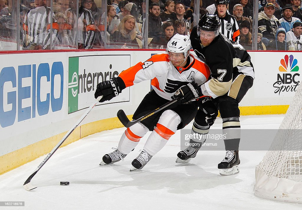 Kimmo Timonen #44 of the Philadelphia Flyers reaches for a loose puck in front of Paul Martin #7 of the Pittsburgh Penguins on February 20, 2013 at Consol Energy Center in Pittsburgh, Pennsylvania. Philadelphia won the game 6-5.