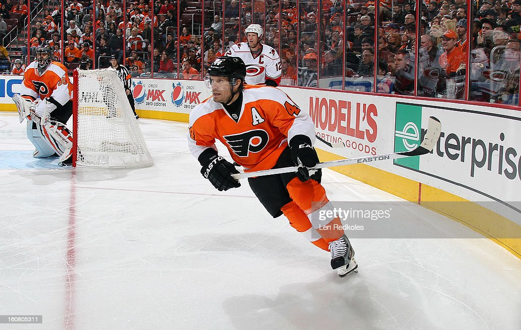 Kimmo Timonen #44 of the Philadelphia Flyers skates out of the corner against Eric Staal #12 of the Carolina Hurricanes on February 2, 2013 at the Wells Fargo Center in Philadelphia, Pennsylvania.