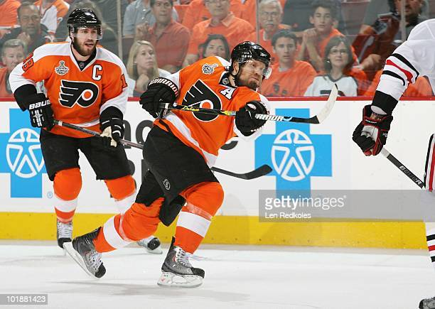 Kimmo Timonen of the Philadelphia Flyers takes a slap shot with teammate Mike Richards looking on against the Chicago Blackhawks in Game Four of the...