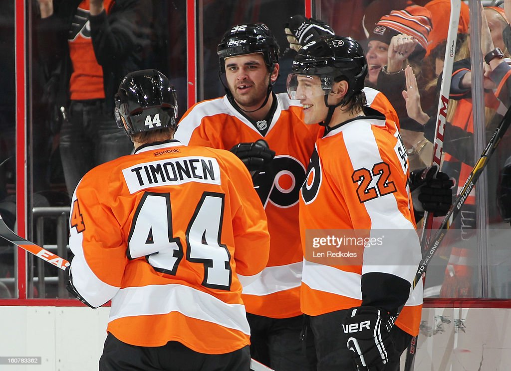 Kimmo Timonen #44, Tom Sestito #32, and Luke Schenn #22 of the Philadelphia Flyers celebrate Sestito's second period goal against the Tampa Bay Lightning on February 5, 2013 at the Wells Fargo Center in Philadelphia, Pennsylvania. The goal was Sestito's first as a Flyer.