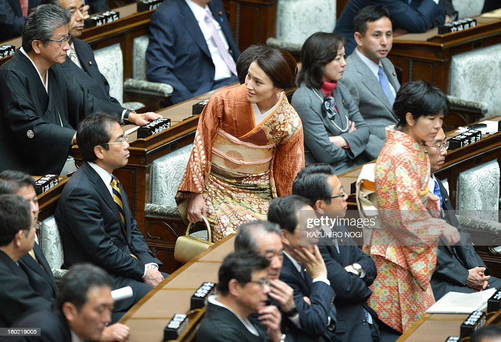 Kimono clad Japanese female lawmakers (C and R) attend the lower house plenary session at the parliament in Tokyo on January 28, 2013 after the opening ceremony of a new 150-day parliament session. Prime Minister Shinzo Abe pledged on January 28 he would not keep stimulus spending 'forever' in a policy speech ahead of a budget that will raise more in taxes than it does from borrowing.