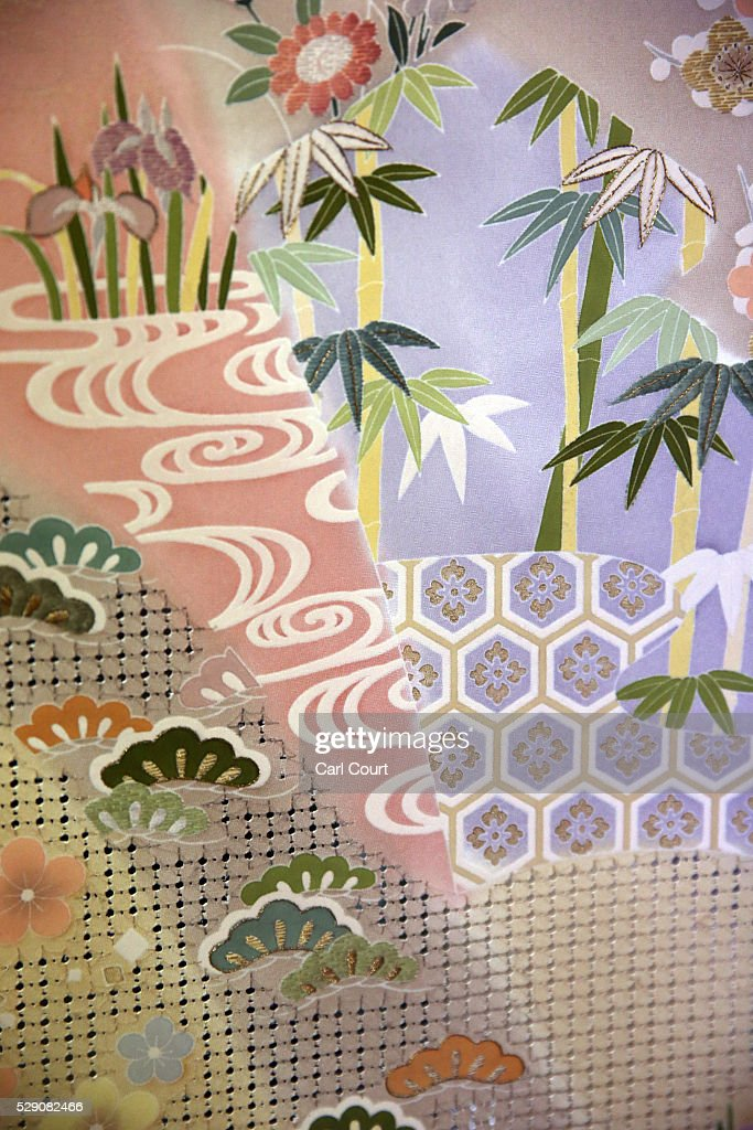 Kimono fabric is displayed after being pressed flat following the painting and dyeing process where it is often creased during a stage of its...