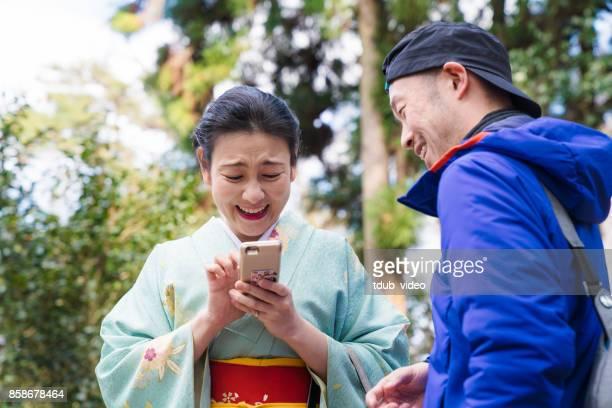 Kimono lady talking with a man