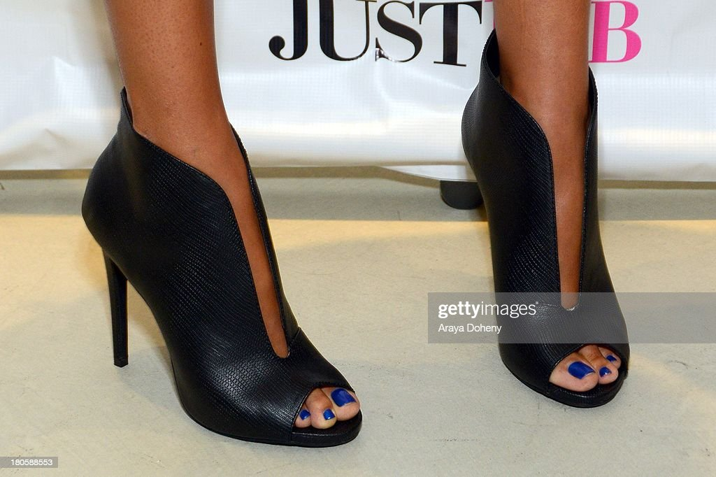 <a gi-track='captionPersonalityLinkClicked' href=/galleries/search?phrase=Kimora+Lee+Simmons&family=editorial&specificpeople=203004 ng-click='$event.stopPropagation()'>Kimora Lee Simmons</a> (shoe detail) attends the JustFab Boutique grand opening with <a gi-track='captionPersonalityLinkClicked' href=/galleries/search?phrase=Kimora+Lee+Simmons&family=editorial&specificpeople=203004 ng-click='$event.stopPropagation()'>Kimora Lee Simmons</a> at JustFab Flagship Store on September 14, 2013 in Glendale, California.