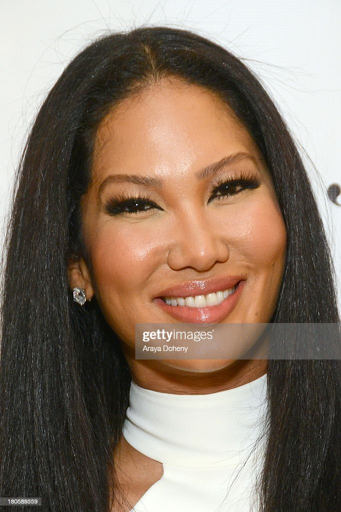<a gi-track='captionPersonalityLinkClicked' href=/galleries/search?phrase=Kimora+Lee+Simmons&family=editorial&specificpeople=203004 ng-click='$event.stopPropagation()'>Kimora Lee Simmons</a> attends the JustFab Boutique grand opening with <a gi-track='captionPersonalityLinkClicked' href=/galleries/search?phrase=Kimora+Lee+Simmons&family=editorial&specificpeople=203004 ng-click='$event.stopPropagation()'>Kimora Lee Simmons</a> at JustFab Flagship Store on September 14, 2013 in Glendale, California.