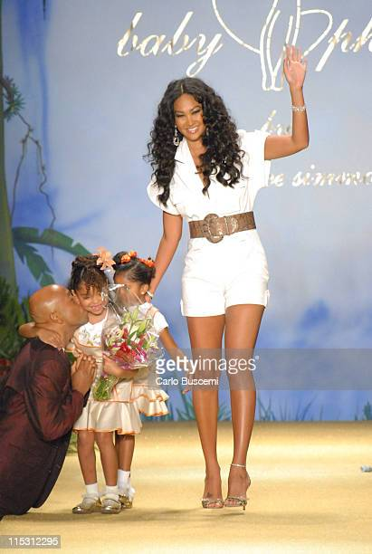 Kimora Lee Simmons designer with Russell Simmons and daughters