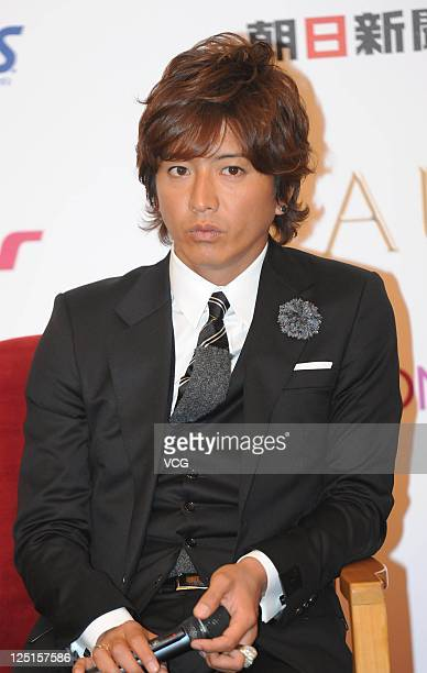Kimura Takuya of Japanese boy band SMAP attends a press conference ahead of Beijing concert at the Great Hall of the People on September 15 2011 in...