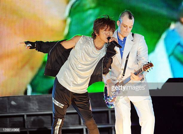 Kimura Takuya of Japanese boy band SMAP performs on the stage at Beijing Concert at Beijing Workers Stadium on September 16 2011 in Bejing China