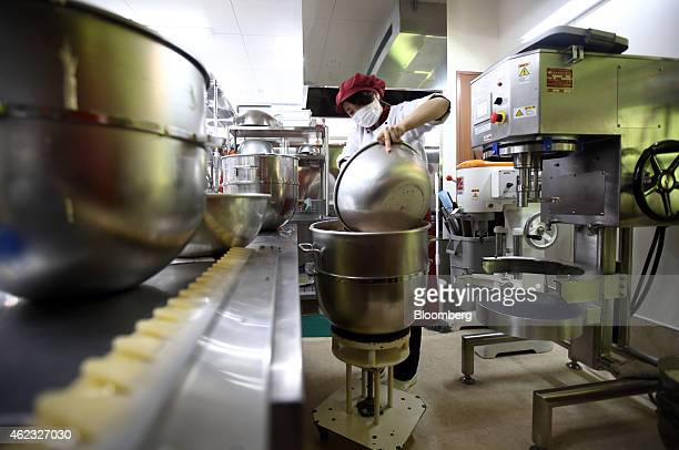 A Kimuraya employee empties a bowl at the company's bakery in Rikuzentakata Iwate prefecture Japan on Saturday Jan 17 2015 President Masayuki Kimura...
