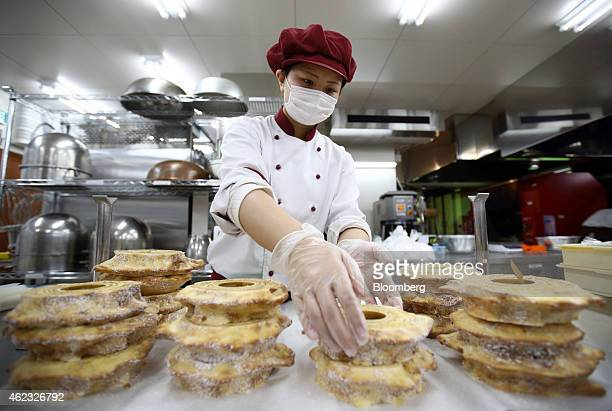 A Kimuraya employee makes final inspections on 'Yume no Itsuki' branded baumkuchen cakes at the company's bakery in Rikuzentakata Iwate prefecture...