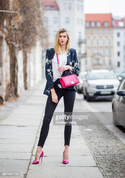Kimyana Hachmann wearing a red Chanel bag Dolce Gabbana red heels Zara blazer Mavi tshirt HM denim jeans on March 24 2017 in Berlin Germany