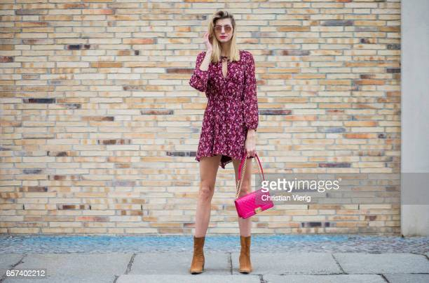 Kimyana Hachmann wearing a red Chanel bag Rayban sunglasses Mango dress vintage ankle boots on March 24 2017 in Berlin Germany
