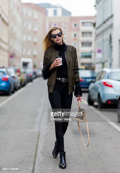 Kimyana Hachmann wearing a top and bomber jacket Zara HM pants Mango ankle boots Louis Vuitton bag Chanel sunglasses during the MercedesBenz Fashion...
