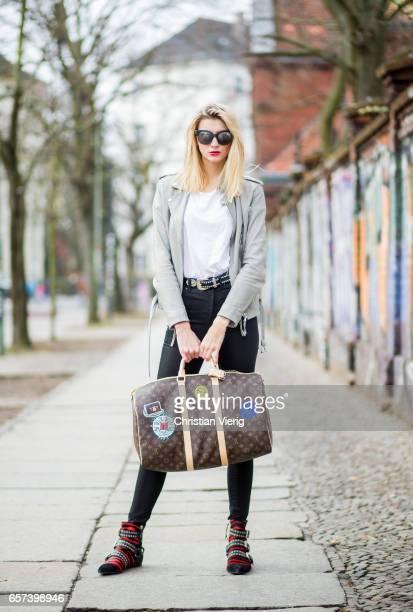 Kimyana Hachmann wearing black HM jeans white Mavi tshirt grey be edgy jacket Chanel sunglasses Louis Vuitton weekender bag Isabel Marant shoes Mango...