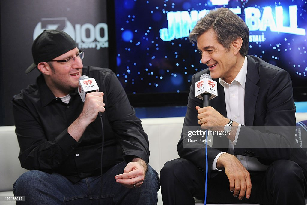 JJ Kincaid and Dr. Oz speak backstage at Z100's Jingle Ball 2013, presented by Aeropostale, at Madison Square Garden on December 13, 2013 in New York City.