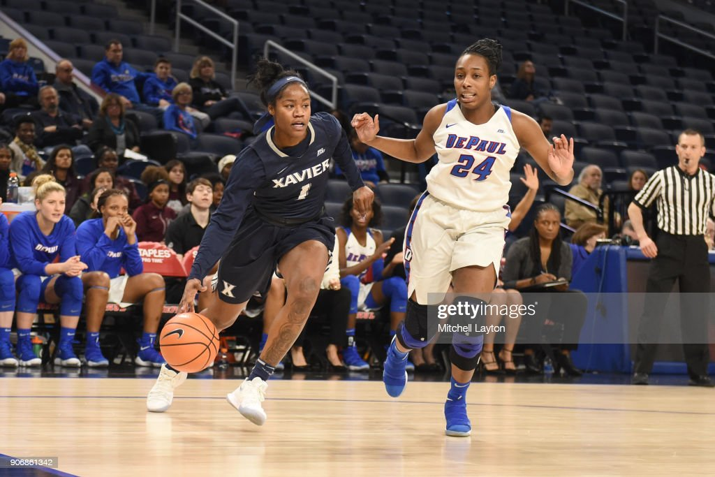 Kindell Fincher #1 of the Xavier Musketeers dribbles by Tanita Allen #24 of the DePaul Blue Demons during a women's college basketball game at Wintrust Arena on January 12, 2018 in Chicago, Illinois. The Blue Demons won 79-48.