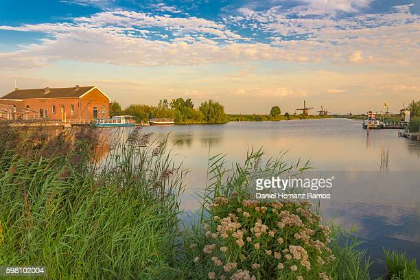 Kinderdijk. A house canal and Windmills at sunset. The Netherlands