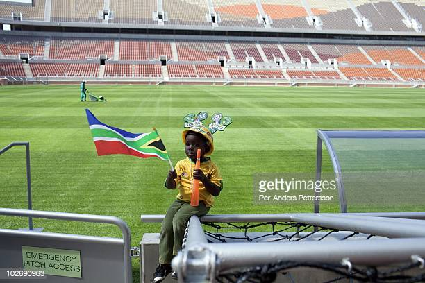 A kindergarten child visits the Peter Mokaba football stadium on May 3 in Polokwane South Africa The stadium has a capacity of 41 and its one of the...