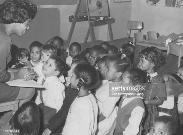 Kindergarten children at Lucy D Slowe School were given a preChristmas breakfast which included entertainment Washington December 24 1966 Here they...