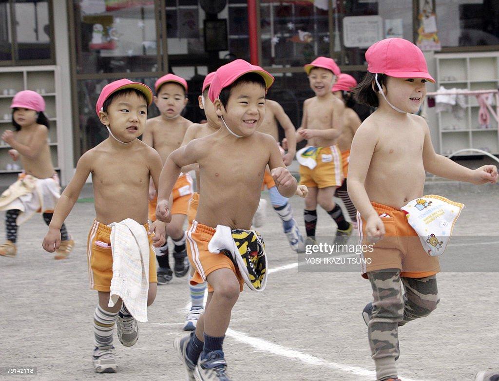 naked childrren Kindergarten children, naked to the waist, run in a playground at Tokyo's  Mizuho kindergarten
