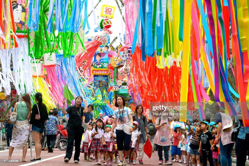 Kindergarten children walk under the colorful ornaments of Tanabata, star festival, during Shonan Hiratsuka Tanabata Festival on July 5, 2013 in Hiratsuka, Kanagawa, Japan.