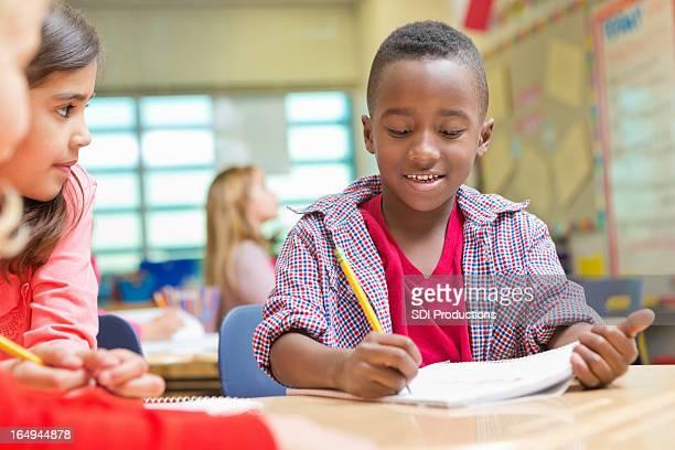 Kindergarten or preschool students reading and writing in public school