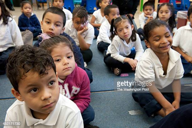 WASHINGTON DC OCTOBER 25 Kindergarten student Brandon Juarez and his classmates listen to their teacher read a book to them at Powell Elementary...