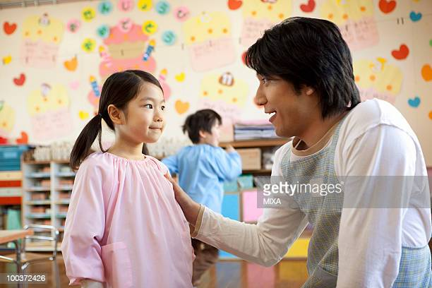 Kindergarten Teacher Talking to Girl