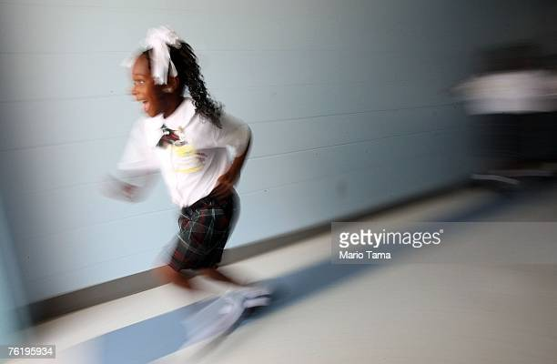 A kindergartner runs toward a playground for recess on her first day of school at Dr Martin Luther King Jr Charter School for Science and Technology...
