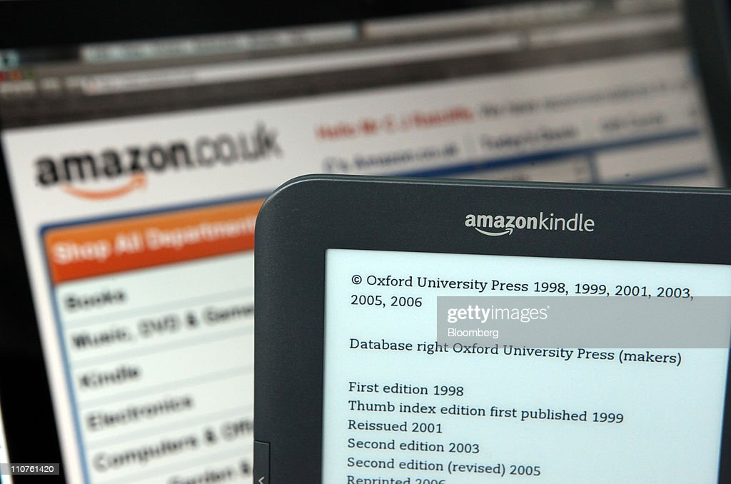 A Kindle 3G electronic book reader, by Amazon.com Inc.,is seen against a backdrop of the company's website in this arranged photograph in London, U.K., on Thursday, March 24, 2011. Amazon.com Inc. Chief Executive Officer Jeff Bezos is using the Kindle, unveiled in 2007, to expand into hardware and fuel digital book demand. Photographer: Chris Ratcliffe/Bloomberg via Getty Images