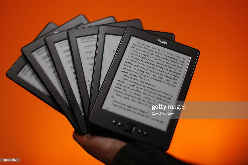 Kindle reading devices are seen at a press conference on September 6, 2012 in Santa Monica, California. Amazon unveiled the Kindle Paperwhite and the Kindle Fire HD in 7 and 8.9-inch sizes, as well as a new price of the basic Kindle at $69.