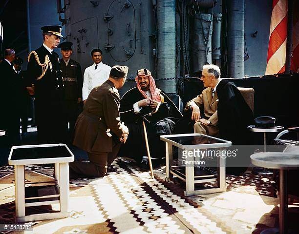 King Abdul Aziz bin Abdul Rahman Al Saud of Saudi Arabia in conference with President Franklin Delano Roosevelt aboard the USS Quincy February 14 1945
