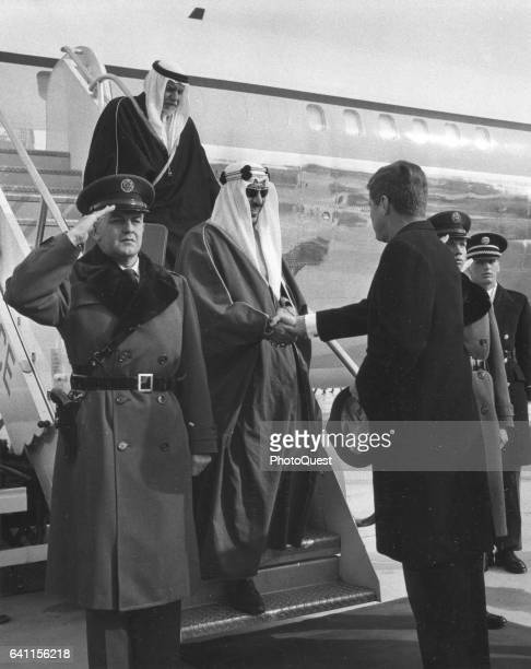 King Abdul Aziz Ibn Saud of Saudi Arabia is welcomed by US President John F Kennedy at Andrews Air Force Base during a state visit Washington DC...