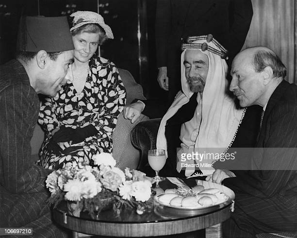 King Abdullah I of Jordan talking to a member of the Transjordanian Legation at the Dorchester Hotel London 1st September 1949 With him are British...