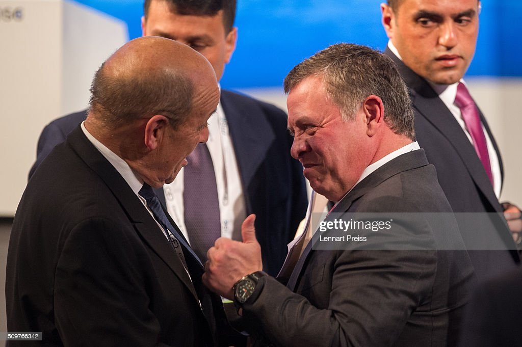 King Abdullah II bin Al Hussein of Jordan (R) shakes hands with french Minister of Defense, <a gi-track='captionPersonalityLinkClicked' href=/galleries/search?phrase=Jean-Yves+Le+Drian&family=editorial&specificpeople=2122785 ng-click='$event.stopPropagation()'>Jean-Yves Le Drian</a>, at the 2016 Munich Security Conference at the Bayerischer Hof hotel on February 12, 2016 in Munich, Germany. The annual event brings together government representatives and security experts from across the globe and this year the conflict in Syria will be the main issue under discussion.