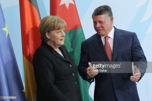King Abdullah II of Jordan and German Chancellor Angela Merkel prepare to depart after speaking to the media following talks at the Chancellery on...