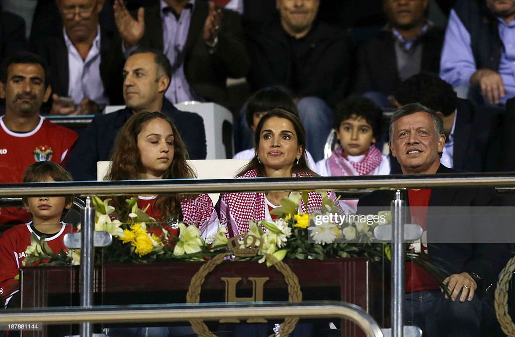 King Abdullah II of Jordan (2ndR) and Queen Rania (C) and their kids attend the FIFA 2014 World Cup qualifier (intercontinental play-off 1st leg) football match Uruguay against Jordan at the International Stadium on November 13, 2013 in the Jordanian capital, Amman. Uruguay won 5-0.