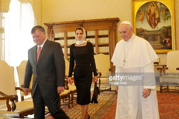 King Abdullah II of Jordan and Queen Rania meet with Pope Francis at the Pope's private library on August 29 2013 in Vatican City Vatican The Pope...