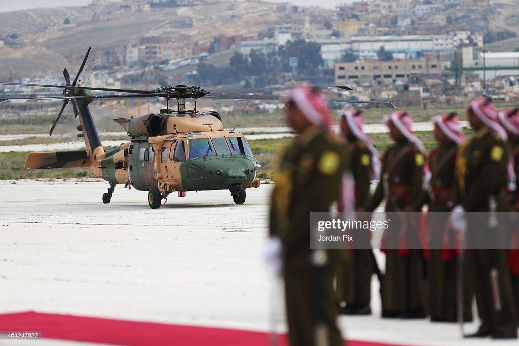 King Abdullah II of Jordan arrives at Marka airport to welcome Emir of Kuwait Sheikh <a gi-track='captionPersonalityLinkClicked' href=/galleries/search?phrase=Sabah+Al-Ahmad+Al-Jaber+Al-Sabah&family=editorial&specificpeople=5573991 ng-click='$event.stopPropagation()'>Sabah Al-Ahmad Al-Jaber Al-Sabah</a> to Amman for talks on February 23, 2015 in Amman, Jordan. During their meeting, the two leaders are expected to discuss regional developments as well as strengthening their economic relationship.